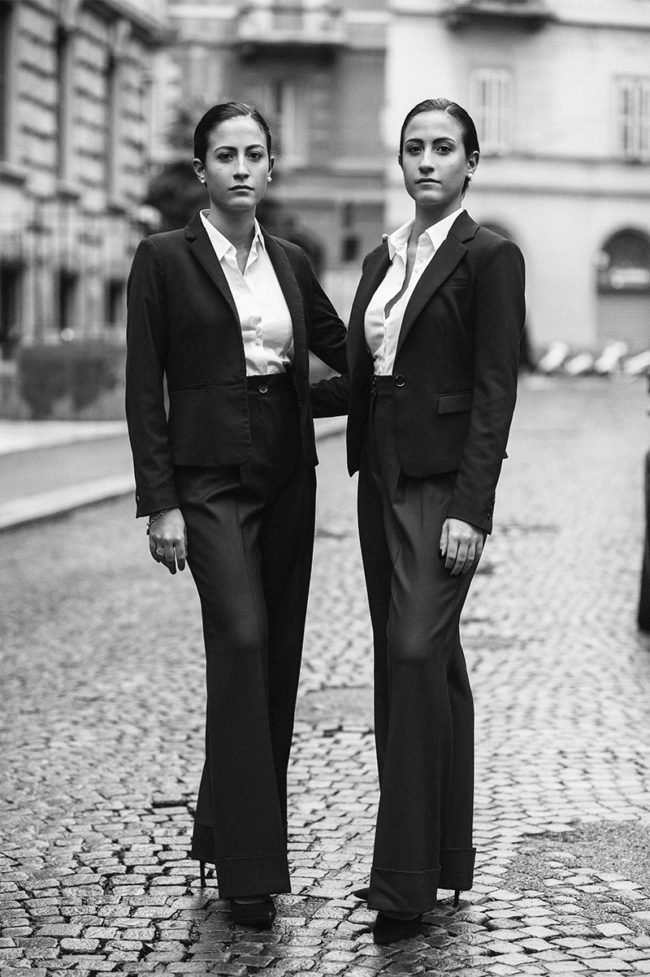 black and white photo of two Italian twins in very elegant dresses